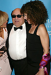 "Katie Couric, Danny Devito and Rhea Perlman.Attending the Star-Studded Benefit, ""Some Enchanted Evening"",  for EIF's National Colorectal Cancer Research Alliane and the Jay Monahan Center for Gastrointestinal Health on Cunard's Queen Mary 2 in New York City..April 24, 2004."