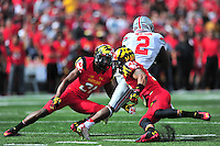 Dontre Wilson of the Buckeyes slip passed the two defenders. Ohio State trounced Maryland 52-24 during a game at the Capital One Field in Byrd Stadium, College Park, MD on Saturday, October 4, 2014.  Alan P. Santos/DC Sports Box