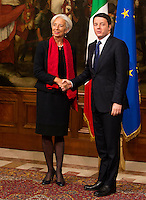 Il Presidente del Consiglio Matteo Renzi stringe la mano al direttore operativo del Fondo Monetario Internazionale Christine Lagarde (FMI) a Palazzo Chigi, Roma, 10 dicembre 2014.<br /> International Monetary Fund (IMF) Managing Director Christine Lagarde, left, and Italian Premier Matteo Renzi shake hands at Chigi Palace government office in Rome, 10 December 2014.