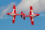 Solo pilots of the Canadian Air Force Snowbirds pass their CT-114 Tutor jets in the knife edge pass during a flight demonstration in September, 2007, during the Reno National Championship Air Races. The Snowbirds are part of the 431 Air Demonstration Squadron and are based out of Moose Jaw, Saskatchewan.The team has flown the Canadian built CT-114 Tutor jet since 1971. Photographed 09/07