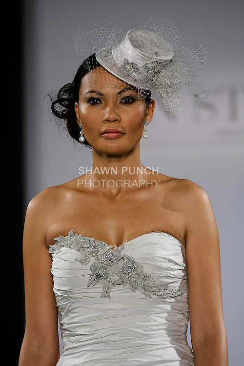 Model walks runway in an Atantis wedding dress from the Ian Stuart - Supernova Bridal Collection 2013 fashion show, at the Couture Show during New York Bridal Fashion Week, October 14, 2012.