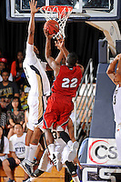 21 January 2012:  FIU center Brandon Moore (22) attempts to block a shot by FAU guard Greg Gantt (22) in the second half as the Florida Atlantic University Owls defeated the FIU Golden Panthers, 66-64, at the U.S. Century Bank Arena in Miami, Florida.
