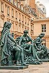 Statues that depict six continents, outside of the Musee d'Orsay, purchased by the French state at the 1878 World Expo in Paris