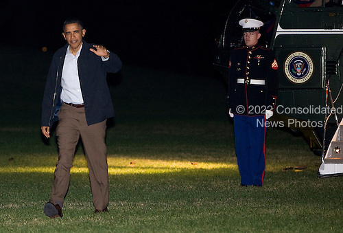 United States President Barack Obama arrives on the South Lawn of the White House in Washington, D.C. aboard Marine One on Sunday, November 20, 2011 following a nine day trip that included stops in Hawaii, Australia and Indonesia. .Credit: Kristoffer Tripplaar  / Pool via CNP