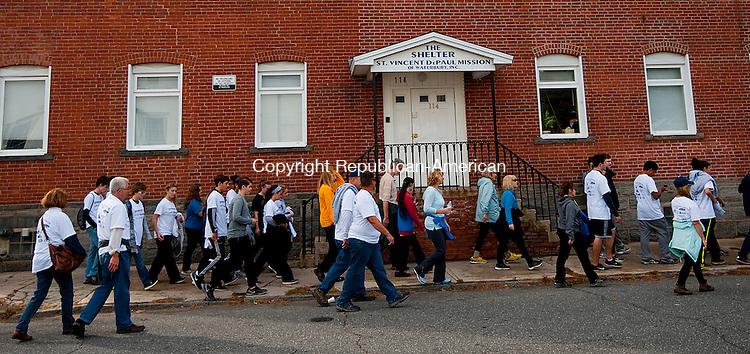 WATERBURY, CT--- -102515JS05---Walkers make their way past the St. Vincent DePaul Mission Shelter in Waterbury during the seventh annual Walk and Race for Mission that started at Library Park in Waterbury on Sunday. 250 walkers and 50 runners participated in the event hosted by St. Vincent DePaul Mission of Waterbury. <br /> Jim Shannon Republican-American