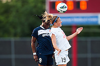 Sky Blue FC forward Danesha Adams (9) goes up for a header with FC Kansas City midfielder Kristie Mewis (19). Sky Blue FC and FC Kansas City played to a 2-2 tie during a National Women's Soccer League (NWSL) match at Yurcak Field in Piscataway, NJ, on June 26, 2013.