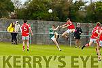St Pats Jordan Conway goes aerial in his effort to block Listry's Sean Lehane shot in Division 3 of the Senior Football County league on Sunday in Blennerville