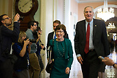 United States Senator Jeff Flake (Republican of Arizona) left, and US Senator Luther Strange (Republican of Alabama) right, led by US Senator Susan Collins (Republican of Maine) walk to the US Senate Chamber for a procedural vote in the US Capitol in Washington, DC on Friday, December 1, 2017. <br /> Credit: Alex Edelman / CNP