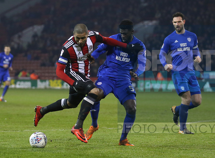 Leon Clarke of Sheffield Utd and Bruno Manga of Cardiff City during the Championship match at Bramall Lane Stadium, Sheffield. Picture date 02nd April, 2018. Picture credit should read: Simon Bellis/Sportimage