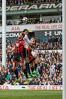 Dele Alli of Tottenham Hotspur is sandwiched between Simon Francis and Adam Smith of Bournemouth during the Premier League match between Tottenham Hotspur and Bournemouth at White Hart Lane, London, England on 15 April 2017. Photo by Mark  Hawkins / PRiME Media Images.