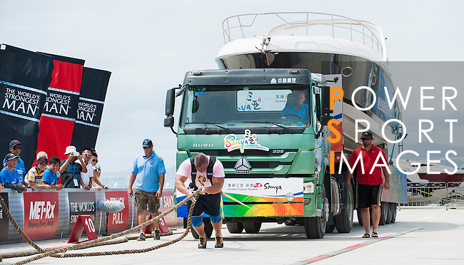 HAINAN ISLAND, CHINA - AUGUST 23:  Terry Hollands of United Kingdom competes at the Truck Pull event during the World's Strongest Man competition at Serenity Marina on August 23, 2013 in Hainan Island, China.  Photo by Victor Fraile