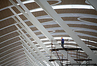 A construction worker at the nearly-completed new terminal of the Pudong Airport expansion project in Shanghai, China.<br /> 12 Mar 2007