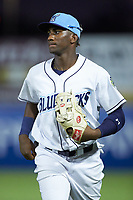 Wilmington Blue Rocks right fielder Seuly Matias (25) jogs off the field between innings of the game against the Fayetteville Woodpeckers at Frawley Stadium on June 6, 2019 in Wilmington, Delaware. The Woodpeckers defeated the Blue Rocks 8-1. (Brian Westerholt/Four Seam Images)