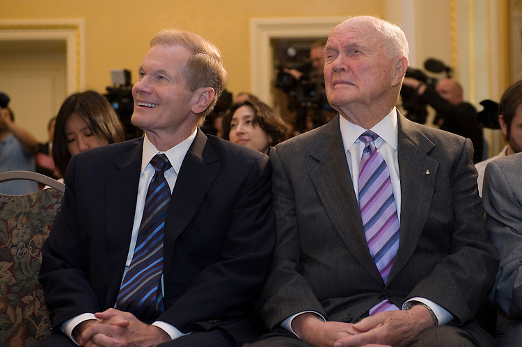 Senator Bill Nelson (D-FL) and former Senator John Glenn during a press conference with Discovery Communications Founder and Chairman John Hendricks' for the official presentation of over 100 hours of newly HD transferred NASA archives to NASA's Administrator Michael Griffin.