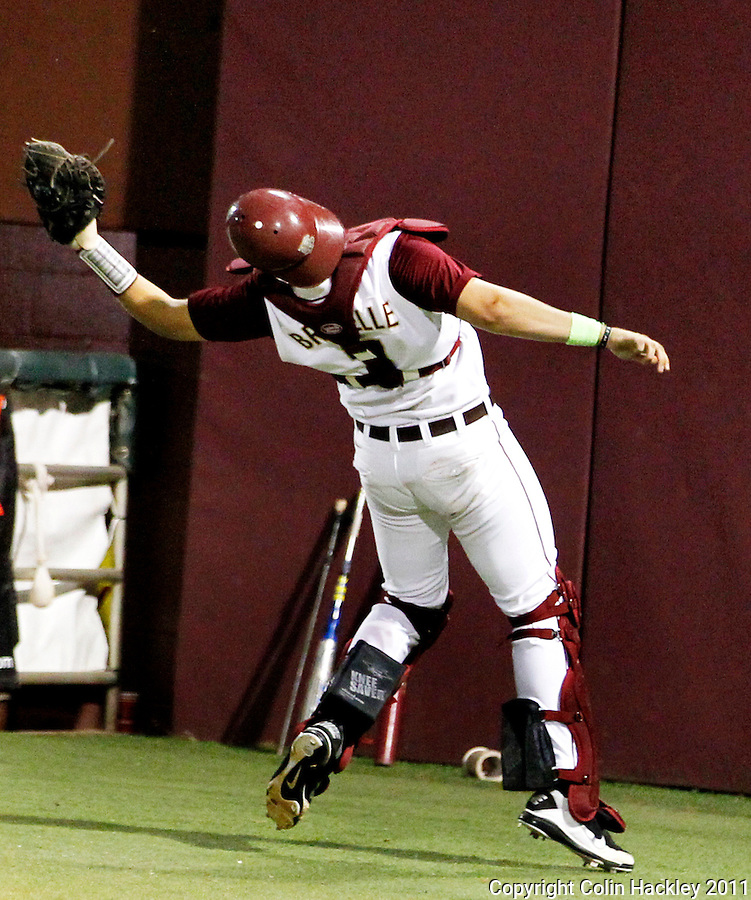 TALLAHASSEE, FL 5/20/11-FSU-CLEMBASE11 CH-Florida State catcher Parker Brunelle bends over backward to catch a Clemson foul ball in the ninth inning Friday at Dick Howser Stadium in Tallahassee. The Seminoles lost to the Tigers 4-7..COLIN HACKLEY PHOTO