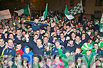 Milltown/Castlemaine manager John Fintan Daly and the players celebrate with the crowd that gathered for the home coming in Milltown on Monday night