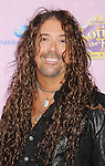 """BURBANK, CA - NOVEMBER 10: Jess Harnell  arrives at the Disney Channel's Premiere Party For """"Sofia The First: Once Upon A Princess"""" at the Walt Disney Studios on November 10, 2012 in Burbank, California."""