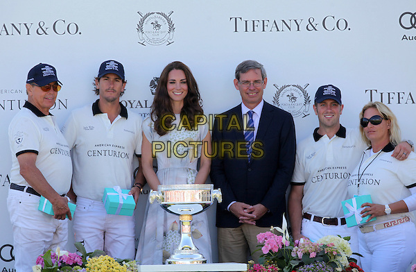Catherine, Duchess of Cambridge.The Foundation Polo Challenge Held At Santa Barbara Polo and Raquet Club, Carpenteria, California, USA, .9th July 2011..half length royal tour royalty kate middleton princess grey gray floral flower print dress cup trophy .CAP/ADM/KB.©Kevan Brooks/AdMedia/Capital Pictures.