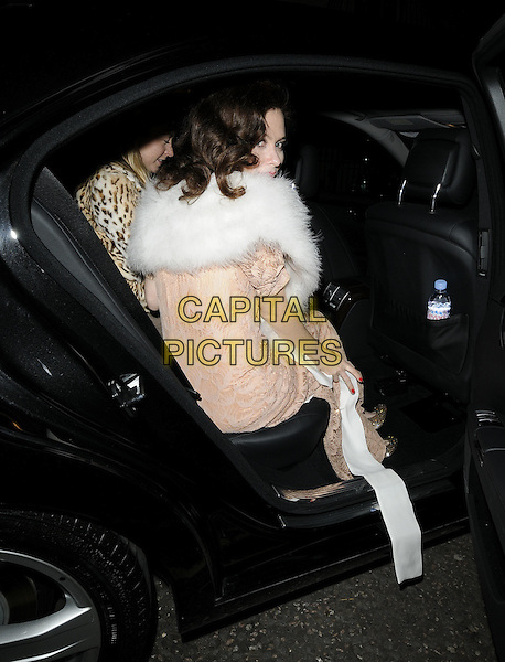"ANNA FRIEL.Seen leaving the theatre after an evening performance of ""Breakfast At Tiffany's', Theatre Royal Haymarket, London, England, UK,.November 19th 2009. .full length white fur shrug jacket peach beige long maxi dress gold shoes pattern vintage sitting getting into car sheer crochet lace see through thru looking back over shoulder rear behind .CAP/CAN.©Can Nguyen/Capital Pictures."
