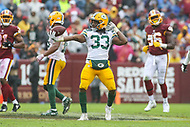 Landover, MD - September 23, 2018: Green Bay Packers running back Aaron Jones (33) celebrates after making a first down during the  game between Green Bay Packers and Washington Redskins at FedEx Field in Landover, MD.   (Photo by Elliott Brown/Media Images International)