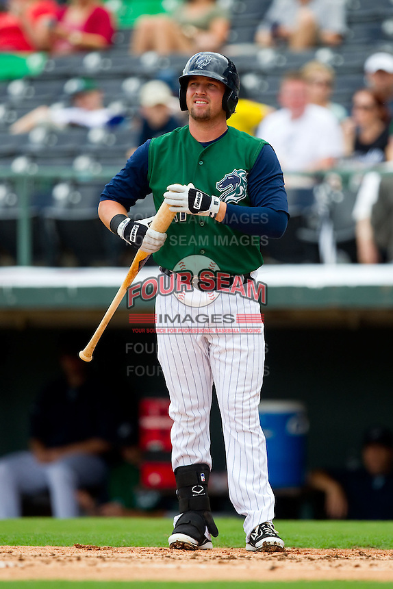 Andy Wilkins (11) of the Charlotte Knights at bat against the Durham Bulls at Knights Stadium on August 18, 2013 in Fort Mill, South Carolina.  The Bulls defeated the Knights 8-5 in Game One of a double-header.  (Brian Westerholt/Four Seam Images)