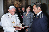French President Nicolas Sarkozy,carla bruni, right, greets Pope Benedict XVI, left, upon his arrival at the Elysee Palace in Paris, Friday, Sept. 12, 2008. .
