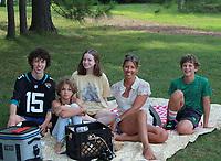 Grady Gottschalk (from left), Rowan Rains, Shannon Cash, Melissa Swann and River Rains enjoy their Apple Seeds picnic basket July 16 at Gulley Park in Fayetteville.<br /> (NWA Democrat-Gazette/Carin Schoppmeyer)