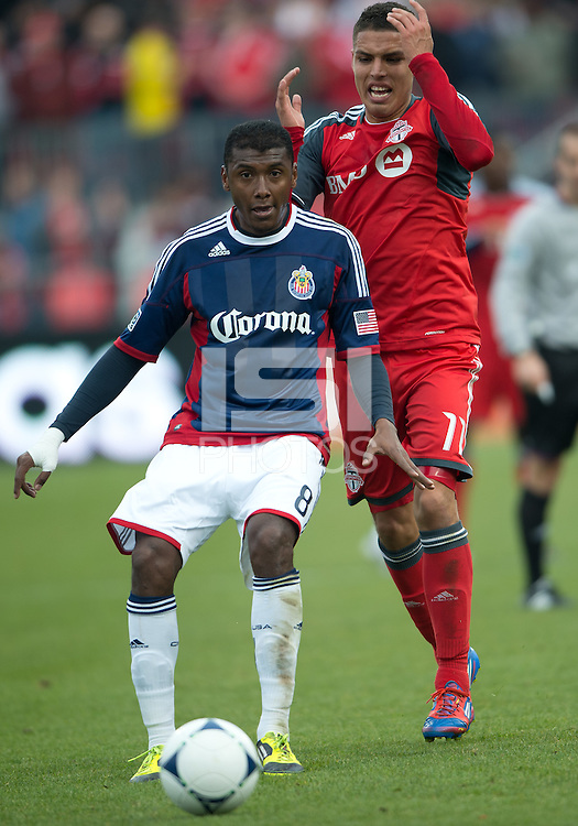 14 April 2012: Chivas USA midfielder Oswaldo Minda #8 and Toronto FC midfielder Luis Silva #11in action during the second half in a game between Chivas USA and Toronto FC at BMO Field in Toronto..Chivas USA won 1-0.