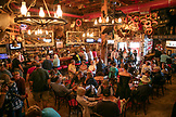ALASKA, Juneau, individuals gather and dine inside of the Red Dog Saloon in downtown Juneau