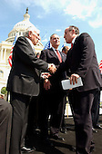 Washington, DC - April 15, 2002 -- United States Representative Ben Gilman (Republican of New York) greets former New York City Mayor Rudolph Giuliani who spoke at the National Solidarity Rally with Israel at the U. S. Capitol on Monday, April 15, 2002.  U.S. Senator Chuck Schumer (Democrat of New York) looks on from center..Credit: Ron Sachs / CNP