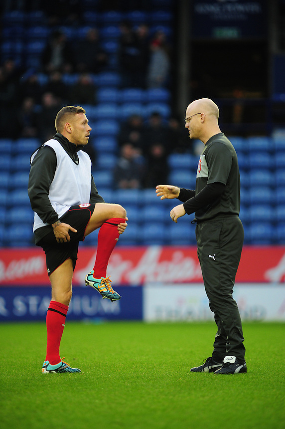 Cardiff City's Craig Bellamy speaks to one of the Cardiff City coaching team during the warm up after appearing to hurt his knee..Football - npower Football League Championship - Leicester City v Cardiff City - Saturday 22nd December 2012 - The King Power Stadium - Leicester..© CameraSport - 43 Linden Ave. Countesthorpe. Leicester. England. LE8 5PG - Tel: +44 (0) 116 277 4147 - admin@camerasport.com - www.camerasport.com