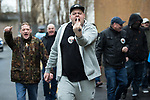 © Joel Goodman - 07973 332324 . 20/01/2018. Doncaster, UK. EDL protesters march through Hexthorpe . Far-right street protest movement , the English Defence League ( EDL ) , hold a demonstration , opposed by anti-fascists , including Unite Against Fascism ( UAF ) in the Hexthorpe area of Doncaster . EDL supporters chanted anti-Roma slogans as they marched through the town . Photo credit : Joel Goodman