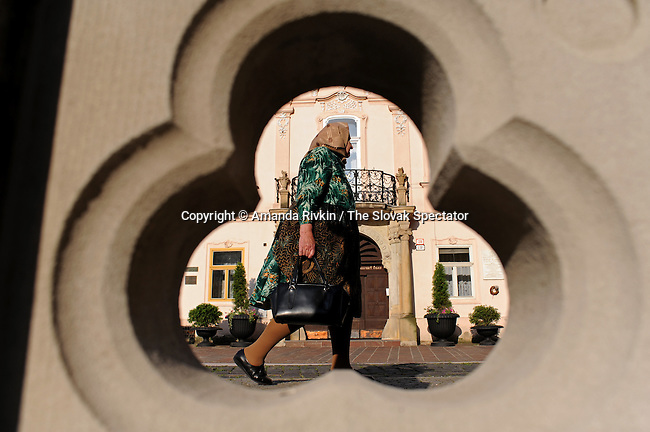 An old woman or babka walks down the Main Street early in the morning in Kosice, Slovakia on June 3, 2010.