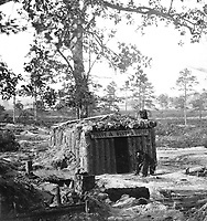 "Bomb-proof Restaurant on the Petersburg Line.  Who but a ""Yank"" would think of starting a ""store"" or restaurant on the line of battle where shot and shell are constantly falling?  Ca.  1864-65.  Stereo.  (National Archives Gift Collection)<br /> Exact Date Shot Unknown<br /> NARA FILE #:  200-CC-1051<br /> WAR & CONFLICT BOOK #:  222"