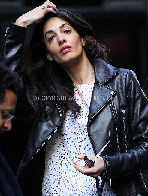 WWW.ACEPIXS.COM<br /> <br /> April 12 2015, New York City<br /> <br /> Amal Clooney joined her hsuband George Clooney on the downtown set of his new movie 'Money Monster' on April 12 2015 in New York City<br /> <br /> By Line: Nancy Rivera/ACE Pictures<br /> <br /> <br /> ACE Pictures, Inc.<br /> tel: 646 769 0430<br /> Email: info@acepixs.com<br /> www.acepixs.com