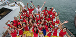 Teams compete during the Hong Kong's Dragon Boat Festival, also known as Tuen Ng Festival, in Stanley beach, Hong Kong on 23 June 2012. This ancient event, commemorates the death of a popular Chinese national hero, Qu Yuan, who drowned himself in the Mi Lo River over 2,000 years ago to protest against the corrupt rulers. Legend has it that as townspeople attempted to rescue Qu Yuan, they beat drums to scare fish away and threw dumplings into the sea to keep the fish from eating his body. Photo by Andy Jones / The Power of Sport Images