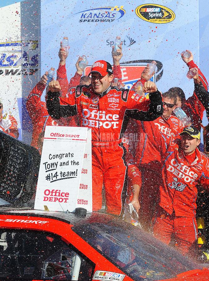 Oct. 4, 2009; Kansas City, KS, USA; NASCAR Sprint Cup Series driver Tony Stewart celebrates after winning the Price Chopper 400 at Kansas Speedway. Mandatory Credit: Mark J. Rebilas-