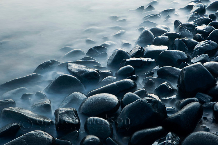 Waves lapping rocks at Pebbly Beach, near Cairns, Queensland, Australia