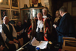Mayoring Ceremony Winchelsea East Sussex. Newly elected Mayor Dr John Spencer being helped into his new robes. <br />