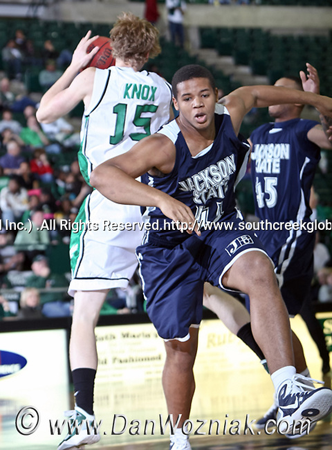 North Texas Mean Green center Ben Knox (15) gets the rebound from Jackson State Tigers forward Raymond Gregory (44)  in the game between the Jackson State Tigers and the University of North Texas Mean Green at the North Texas Coliseum,the Super Pit, in Denton, Texas. UNT defeated Jackson 68 to 49