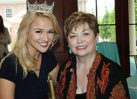 NWA Democrat-Gazette/CARIN SCHOPPMEYER Miss America Savvy Shields, Miss America (left), visits with Donna Axum Whitworth, Miss America 1964 and founding member of the University Women's Giving Circle, at a reception in Axum Whitworth's honor April 20 at the Fowler House Conservitory on the UA campus in Fayetteville.