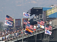 Nov 11, 2018; Pomona, CA, USA; American flags and NHRA flags fly near the main grandstands during the Auto Club Finals at Auto Club Raceway. Mandatory Credit: Mark J. Rebilas-USA TODAY Sports