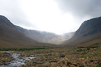 sun beam through clouds in a glacial valley