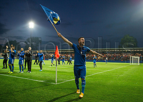 03.06.2016. Volksbank-Stadion, Frankfurt, Germany. International football friendly, Kosovo versus Faroe Islands.  Flamur Kastrati (Kosovo) celebrates their win with the national flag