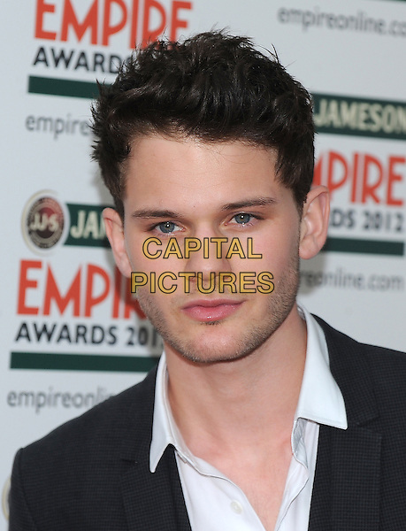 Jeremy Irvine .Jameson Empire Film Awards at the Grosvenor House Hotel, Park Lane, London, England..March 25th 2012.headshot portrait white black stubble facial hair .CAP/BF.©Bob Fidgeon/Capital Pictures.