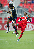 Philadelphia Union defender Sheanon Williams #25 and Toronto FC forward Joao Plata #7 in action during an MLS game between the Philadelphia Union and the Toronto FC at BMO Field in Toronto on May 28, 2011..The Philadelphia Union won 6-2..
