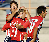 The Chivas USA players Daniel Paladina and Jonthan Bornstein congratulate Ante Razov after scoring a goal. The Chivas USA and New England Revolution played to 1-1 draw during an early round of the 2008 SuperLiga at Cal State Fullerton Titan stadium in Fullerton, California on Sunday July 20, 2008.