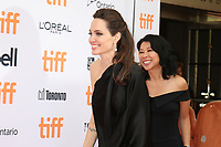 DIRECTOR ANGELINA JOLIE AND WRITER LOUNG UNG - RED CARPET OF THE FILM 'FIRST THEY KILLED MY FATHER' - 42ND TORONTO INTERNATIONAL FILM FESTIVAL 2017