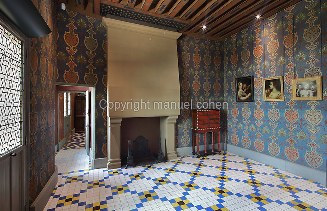 Garde-robe de la Reine, or Queen's Dressing Room, in the Francois I wing, built early 16th century in Italian Renaissance style, at the Chateau Royal de Blois, built 13th - 17th century in Blois in the Loire Valley, Loir-et-Cher, Centre, France. The hand-painted wallpaper, tiled floor and painted ceiling were restored by Felix Duban in 1861-66. The chateau has 564 rooms and 75 staircases and is listed as a historic monument and UNESCO World Heritage Site. Picture by Manuel Cohen