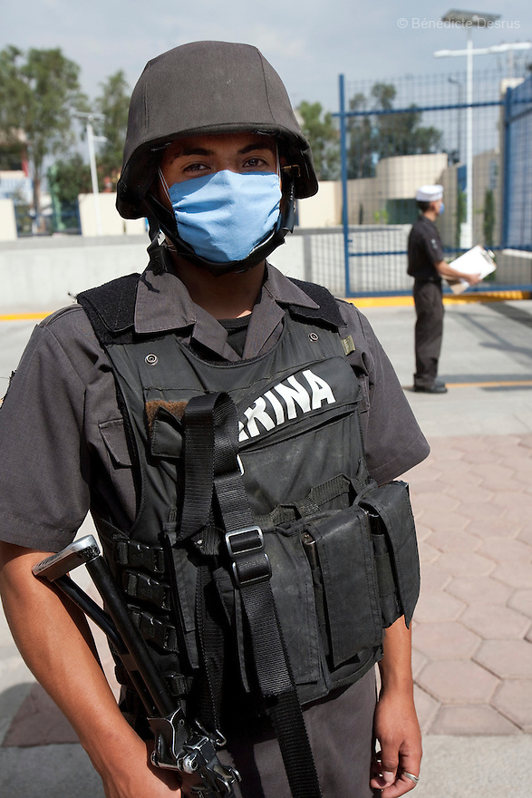 30 april  2009 - Mexico City, Mexico - A marin wears surgical mask to protect himself from Swine Flu at the Naval hospital in Mexico City..Mexico opened up its newly built national naval hospital to civilians to deal with the overwhelming number of suspected swine flu cases. Staffers wore goggles, masks and booties to protect themselves while treating patients. The high quality of care stands in stark contrast to most neighborhood hospitals in Mexico City which don't have the staff or resources to deal with the influx of new Flu cases. World health officials raised a global alert to an unprecedented level as the swine flu was blamed for more deaths in Mexico and the epidemic crossed new borders, with the first cases confirmed Tuesday in the Middle East and the Asia-Pacific region. Photo credit: Benedicte Desrus / Sipa Press